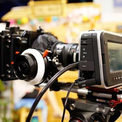 image of a blackmagic cinema camera filming in a brightly lit environment